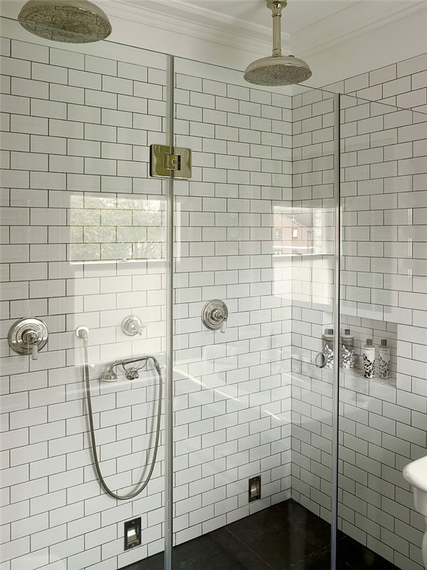 dark floor in shower, white subway tile with grey grout.