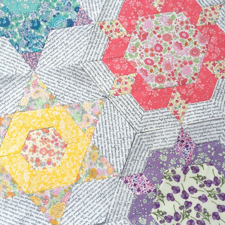 EPP flowery quilt in Liberty of London fabrics with b+w text as background