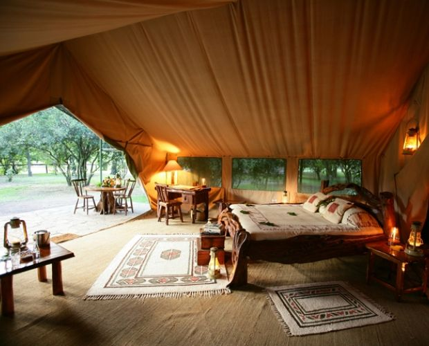 GOVERNORS' II MORAN CAMP- is in the Masai Mara, has been kept as small as possible, with added touches that make this the top of the range safari. The atmosphere of the original hunting camps has been recreated here. Hidden under ancient trees, deep in the forest, are just 10 tents, which line the winding banks of the Mara River.