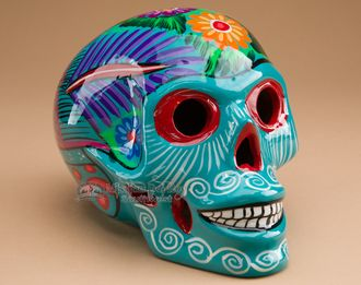 This is a beautiful southwestern day of the dead skull. Handcrafted in Mexico, this skull is hand painted ceramic, one of the favorites among day of the dead meorabilia. So popular in the southwestern