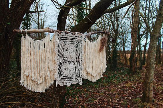This wall hanging has two sets of tassels that hangs from a handpicked but of driftwood found on the Devonshire coastlines. Doubled up with texture on the sides, it leaves the middle to speak for its self. With crochet flowers in an organic cotton. Measuring in at 38inches wide and 20