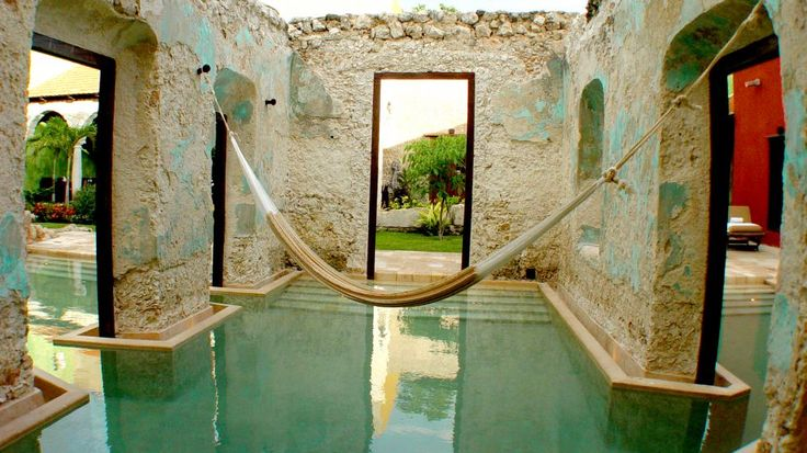 Hacienda Puerta Campeche, Mexico consists of a row of restored 17th century houses with an indoor/outdoor pool twisting through its rooms.