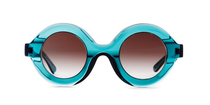 Glare - Design Sunglasses with a round shape. Mod. GIORGIA col. 259. The frame is totally hand made in Italy with the best material available on the market.