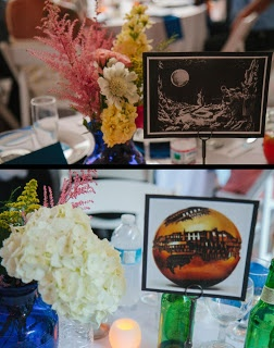 Unique table signs each depicting great works of art with a celestial theme of sun, moon or stars