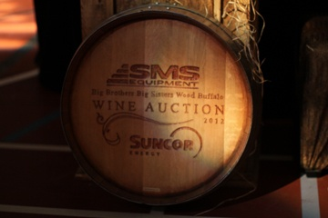 Hand crafted wine barrel signs were given to the event's top sponsors as a unique memento of their support of the wine auction.