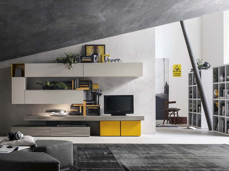 Equilibrio cromatico e tanto design: living di mobilificio Santa Lucia in rovere cenere, Eco kashmir e laccato opaco mango.