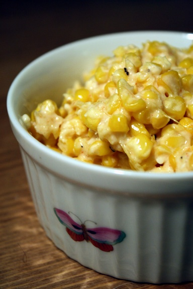 Roasted corn with lime, parmesan and chili. Replace the parm with queso fresco and I am a happy girl!