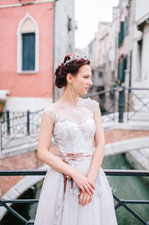 lavender shade lace bridal dress / http://www.deerpearlflowers.com/unique-sophisticated-wedding-dresses-from-cathy-telle/2/