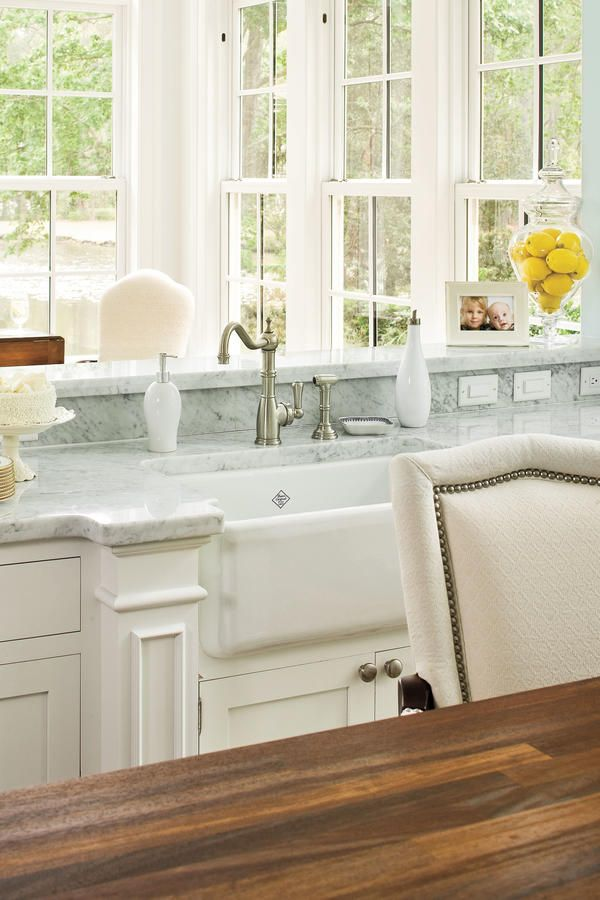 Sunny Farmhouse Sink - Farmhouse Sinks with Vintage Charm - Southernliving. This elegant white sink is brightened with a marble countertop and a light-filled view of the sunroom. See more of this Simply Elegant Kitchen Love it? Get it! Sink: Shaws Original Single-Bowl Fireclay Apron Sink (RC3018) from Rohl, available through Cregger Company, Inc.
