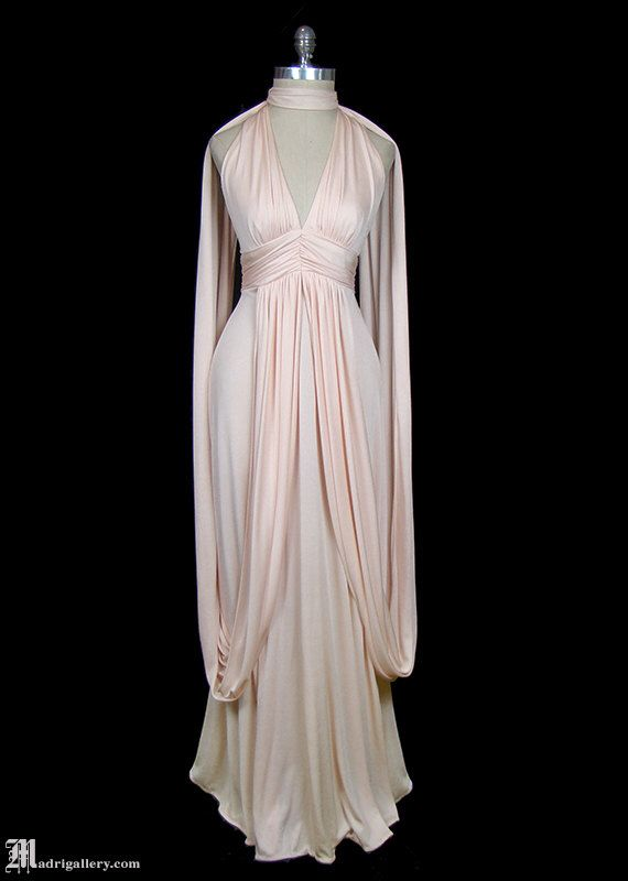 Halston grecian goddess draped jersey maxi dress, vintage 1970s 70s synthetic knit, couture evening or wedding gown, caped, avant garde by TheFrockDotCom on Etsy https://www.etsy.com/listing/259093808/halston-grecian-goddess-draped-jersey