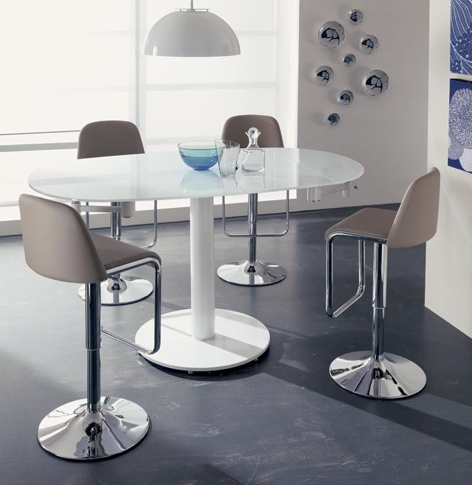 EXTRA UP. Extra UP presents a higher height suitable for the stools of EasyLine collections.  It is available in fashion finishes of a young and fresh look. Extending dining table with metal column, glass top and visible extensions under the top. http://www.easy-line.it
