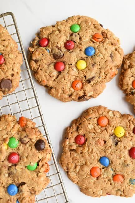 This classic recipe is kicked up a notch and made GIANT! Peanut butter and M&M's work together to create the best cookie recipe ever! #monstercookies #cookies #cookierecipe #iambaker