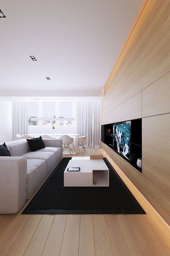 Clean TV cabinets in living room with white couch