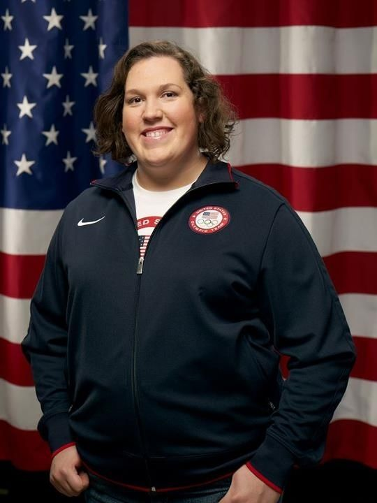 """""""Beauty is strength,"""" motto of Sarah Robles, American weight lifting Olympian this year in London. She lives in poverty, but has never given up on her dream. She doesn't get sponsors because she doesn't fit the image of what a young Olympian should look like. The article linked to this picture blew me away. Totally worth the read!"""