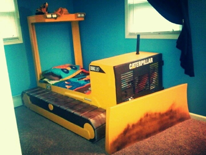 My husband custom built this Caterpillar Bulldozer bed for our son. Perfect for a construction theme room!