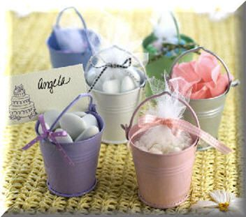 Sand buckets... could use these for placecards (tie name/table to the handle) and fill with something yummy.    Like those shell shaped chocolates I found before.