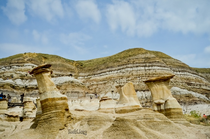 Hoodoos are eroded pillars of soft sandstone rock, topped with a resilient cap. Located at Drumheller, Alberta, Canada.