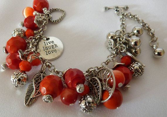 Check out this item in my Etsy shop https://www.etsy.com/au/listing/242961925/orange-and-silver-beads-chained-bracelet