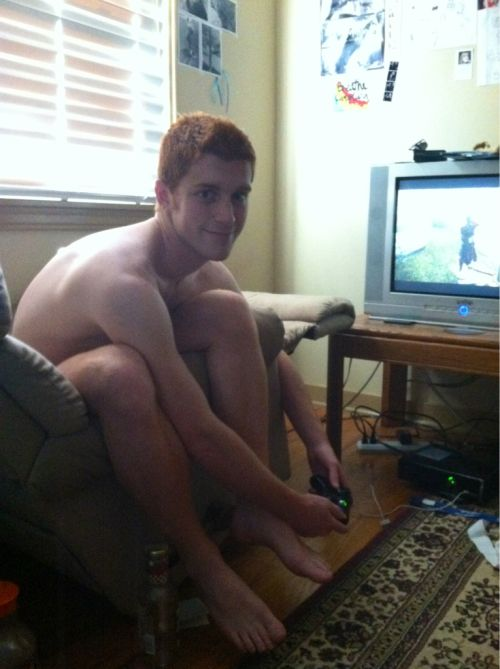 redhead playing video games naked