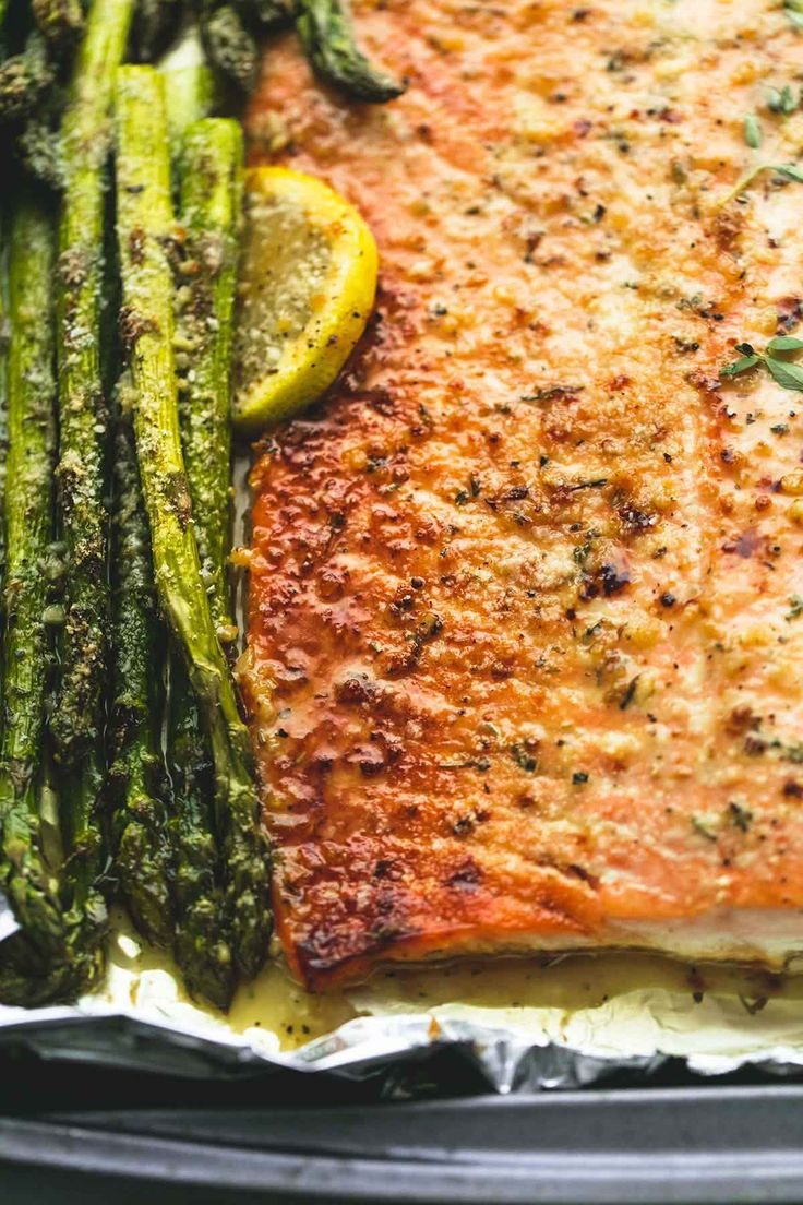 Flaky, perfectly baked lemon parmesan salmon & asparagus in foil is an easy and healthy 30 minute meal with fantastic flavor.   This recipe. It's EVERYthing. It's the dinner for rescuing busy Tuesdays