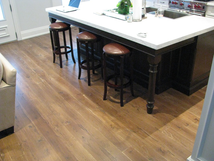 Located in Toronto Ontario - Scraped plank ash flooring, custom stained using jacobean and grey tones.  Finished with commercial 2 part epoxy finish.