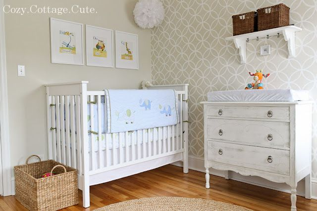 Love this nursery!  Kind of want to use it for inspiration in Oscars big boy room since I'm not going to do the nursery over, although now I want to!  ;o). Love the stenciled wall and love the colors but may go with a pale blue. Oscar wanted a blue room. Love the baseboard too. It looks faux big.