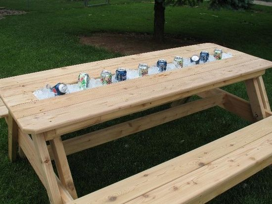 There's no need to bring the cooler to the table when it's already built in. This rain gutter ice caddy was made by removing most of the center slat of a picnic table and replacing it with a gutter of the same dimensions