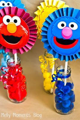 Sesame Street/Elmo themed birthday party!  Come check out Melly Moments Blog for all of the DIY decorations and free printables to download!!  Includes characters like Big Bird, Elmo, Grover, Oscar, Abby Cadabby, Bert/Ernie, Cookie Monster, Murray, and Snuffleupagus