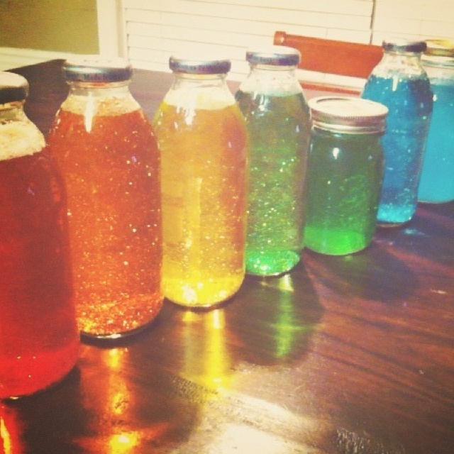 Cute little mind jars made with water, food coloring, and a TON of glitter.
