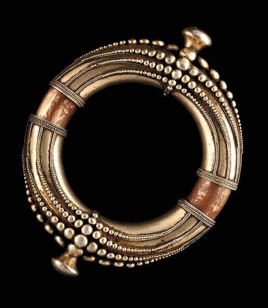 Indonesia ~ Sumatra   Classic Batak Karo bracelet. Silver gilt over red copper.