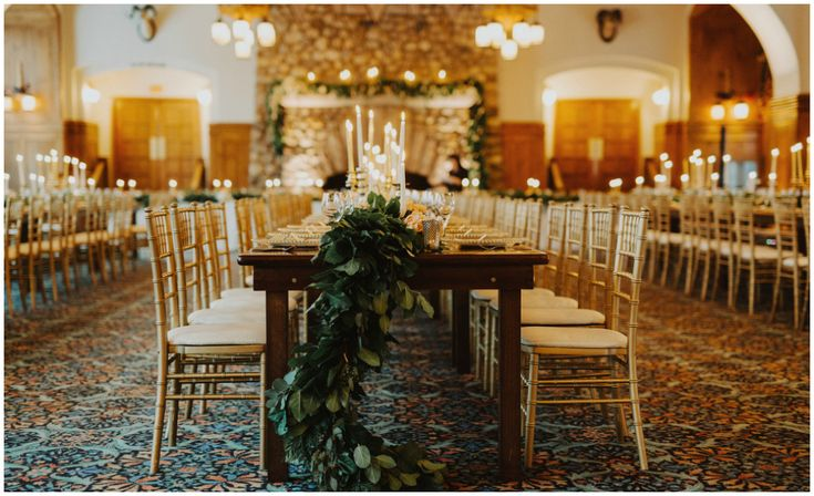 Wooden Harvest Table with Gold Chiavari Chairs and Greenery Garland Centrepiece.