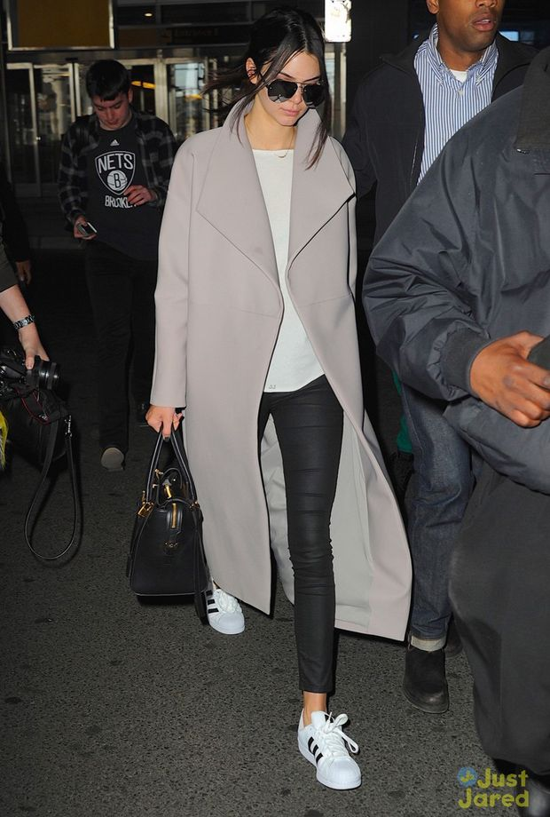 The shoes. With grey long duster jacket, black jeans and basic white top. Kylie Jenner