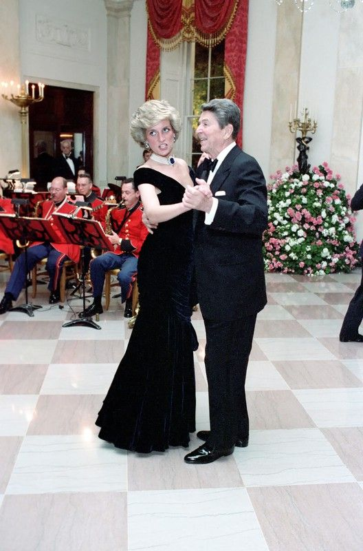 Princess Diana dances with President Reagan  at a White House State dinner in November 1985. Diana wore a midnight blue velvet gown by Victor Edelstein.
