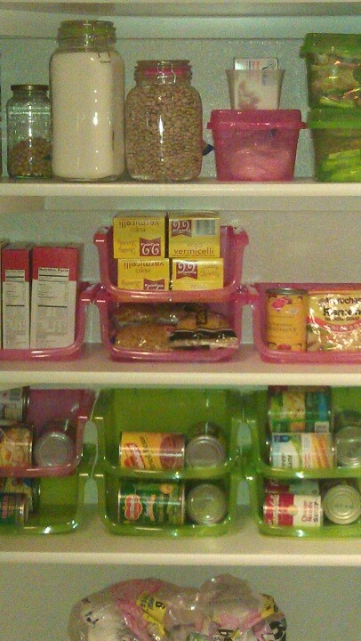 Organizing pantry with all stackable bins from dollar tree.. still working on it