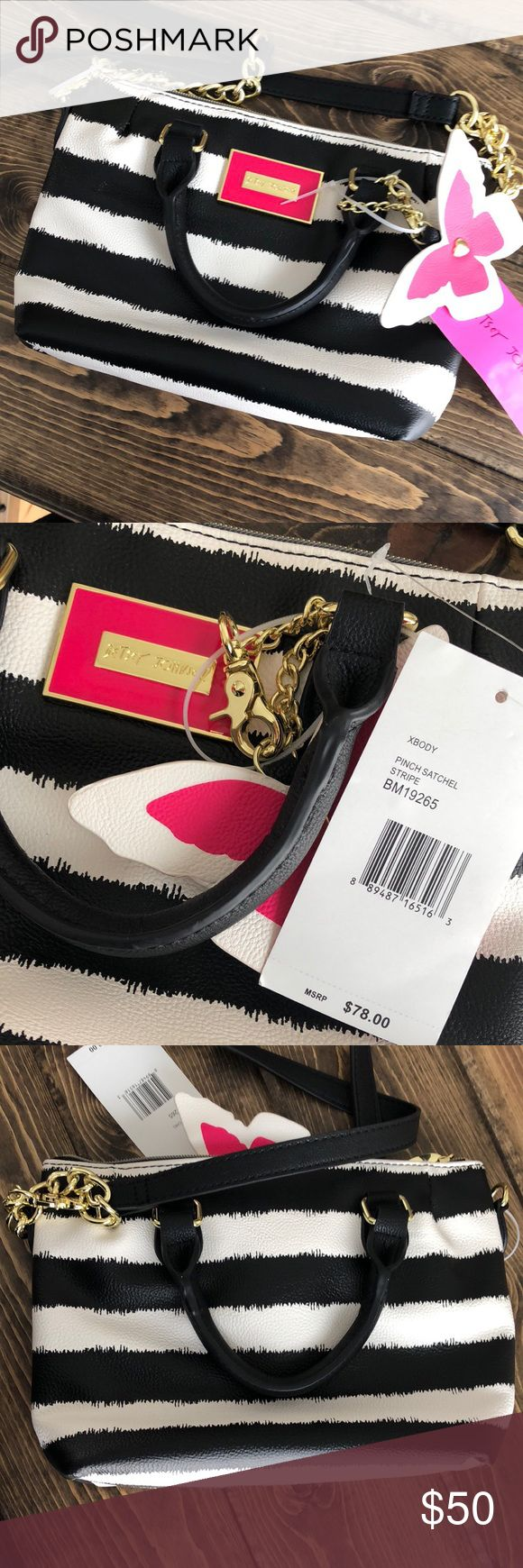 NWT*Betsey Johnson crossbody purse *NWT* Cute crossbody purse by Betsey Johnson. Black and white stripes with gold chains. The inside is floral (pictured). The butterfly is detachable. The crossbody strap is also detachable and there are hand straps.  Send me a reasonable offer! Betsey Johnson Bags Crossbody Bags