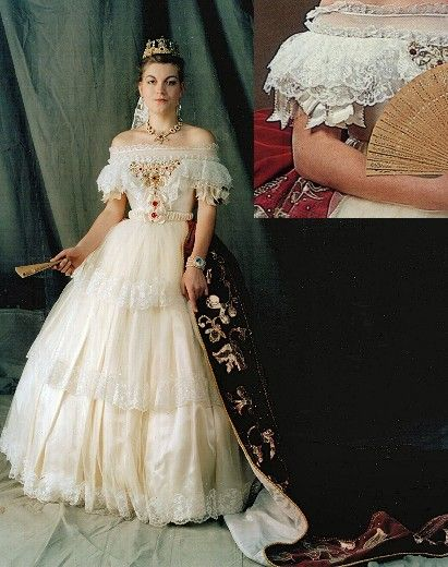 This ivory lace and tulle gown was inspired by a painting of   Elizabeth of Austria from a painting by Franz Russ, (c.1860).triple layered lace skirt over crinoline hoop. Velvet train with appliquéd detail. Intricately beaded boned bodice  over typical mid-nineteenth century corset. Complete reproduction costume including corset, crinoline, petticoats, bum-roll, beading. From £1200