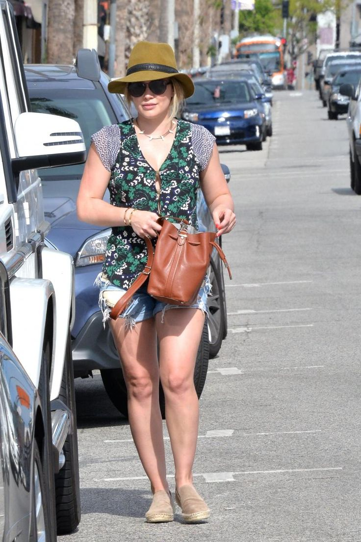 Hilary Duff wearing Rag & Bone Floppy Brim Fedora in Mustard, Rag & Bone the Boyfriend Shorts in Rebel, Proenza Schouler Bucket Bag and Dior Technologic Sunglasses