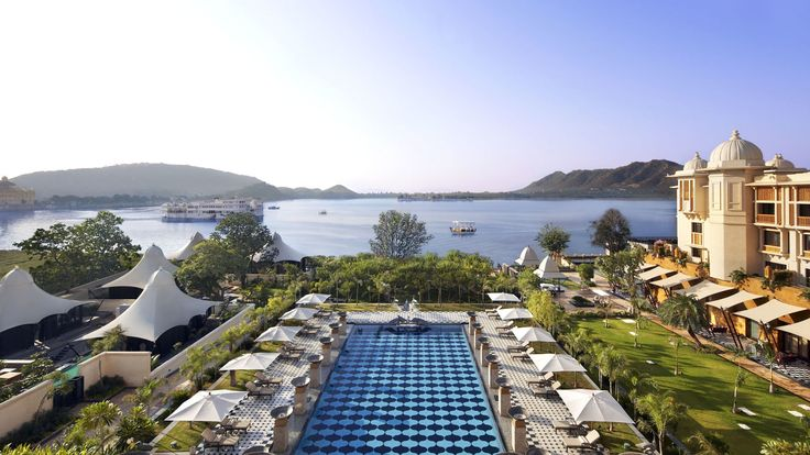 Gaze out over soul-stirring Lake Pichola in Udaipur from the prime vantage point of own your balcony. The lake, built in 1362, and misty Aravalli Mountains lie in the distance. The Leela Palace Udaipur, theleela.com.   - HarpersBAZAAR.com