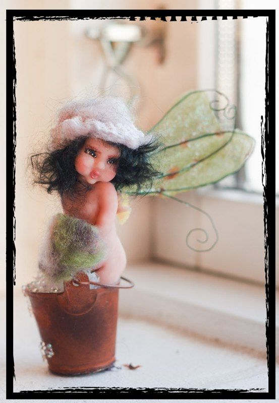 from polymer clay , sculpt from a picture drawn by Christel Marott