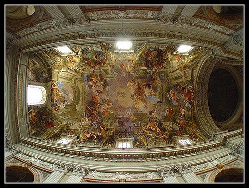 The Apotheosis of St. Ignatius painted by the illusionist master Andrea Pozzo. Standing in the center below on a brass disc, it appears the ceiling is higher than it actually is.