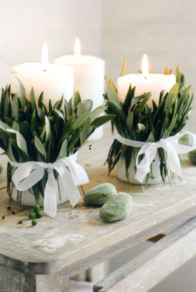 Go dreamy with some foliage-wrapped candles as centerpieces.