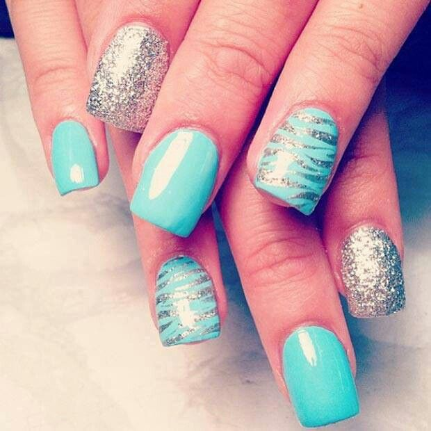 blue zebra striped with a sparkley accent nails.