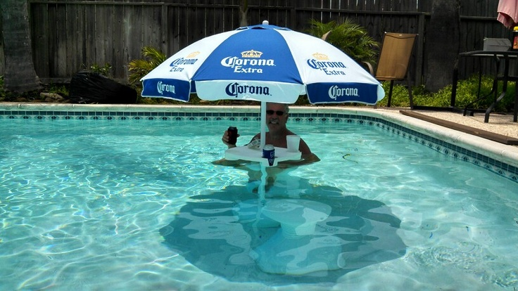 Diy Umbrella Table For Pool Just Took A Plastic Umbrella Base Filled With Sand Added An Umbrella T Diy Swimming Pool Pool Umbrellas Swimming Pool Designs