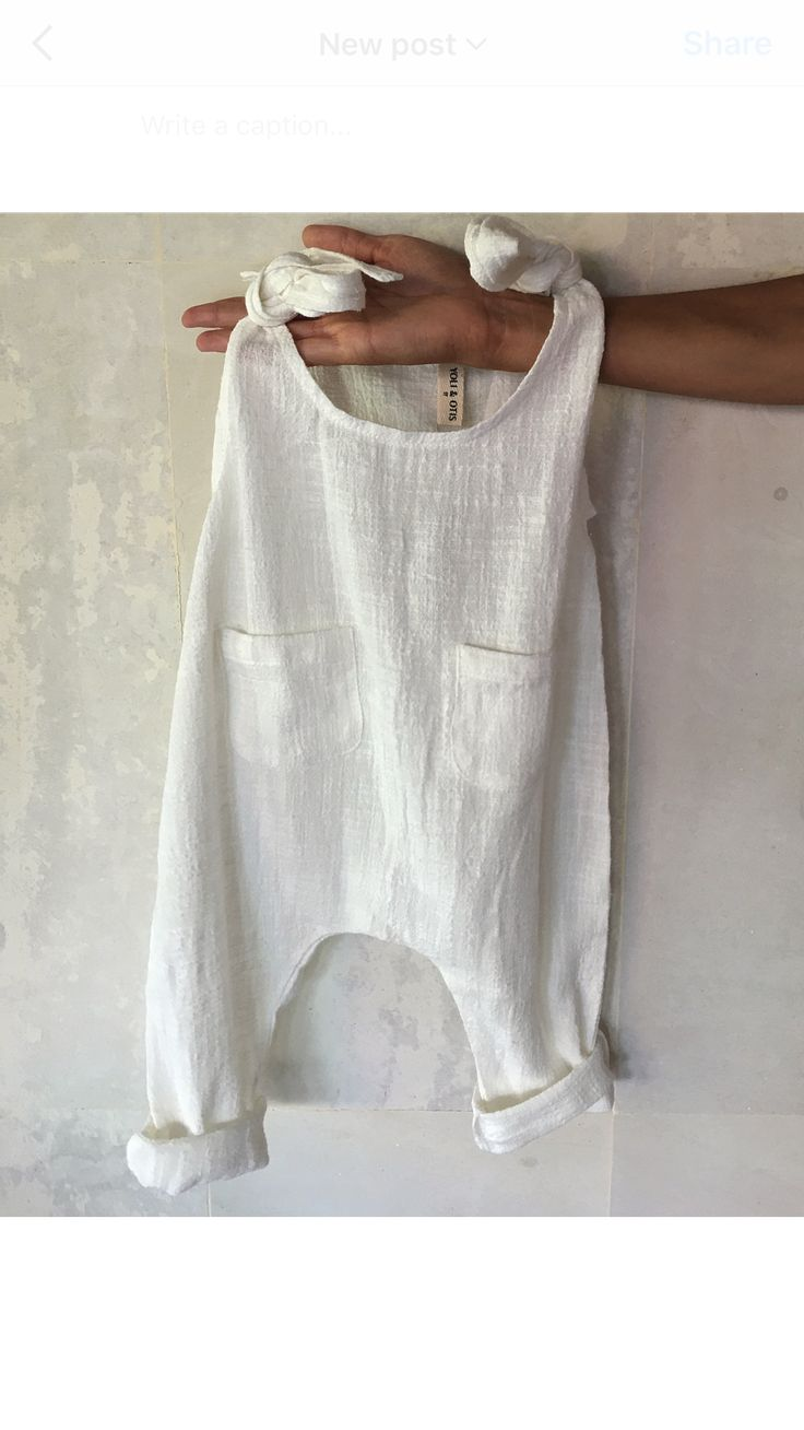 Great crisp white or Ivory jumper choice could be worn with cardigan for layering. www.yoliandotis.com