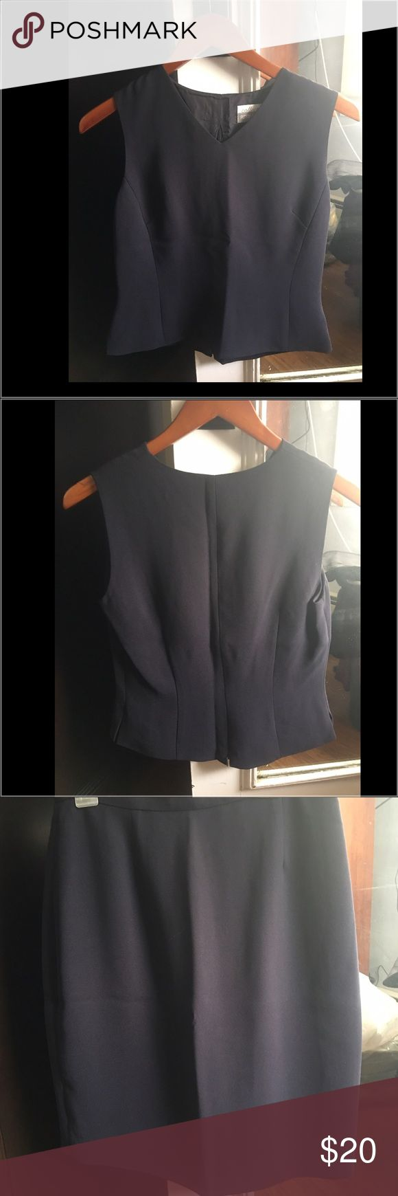Classic Women's Navy 2 piece business suit Timeless navy Petite Sophisticate Collectibles 2 piece suit. Top is sleeveless with V neck front. Zips up back worn untucked with skirt. Skirt is above the knee with back zip and button. This is being sold together only. Petite Sophisticate Collectibles Other