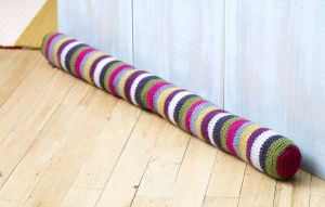 Striped Draft Stopper.  Free pattern from Lion Brand.   (Modify for bolster?)