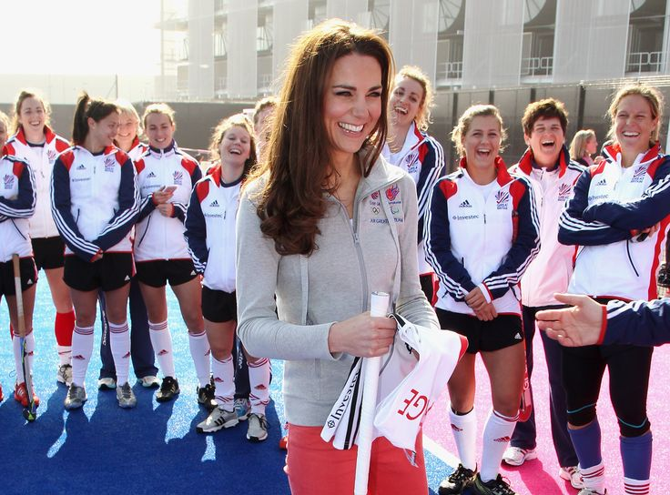 Sticks and Stones: Kate Middleton laughed with the Great Britain hockey team in London's Olympic Park.