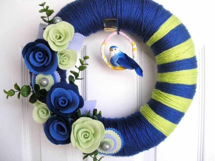 A FEW STRIPES  Navy and Lime- Yarn Wreath with Felt Flowers - The Original Felt Yarn Wreath. $60.00, via Etsy.