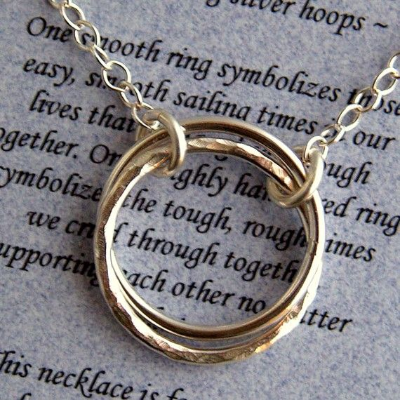 sister journey necklace with interlocking rings one smooth ring symbolizes easy fun times. roughly hammered ring symbolizes rough times