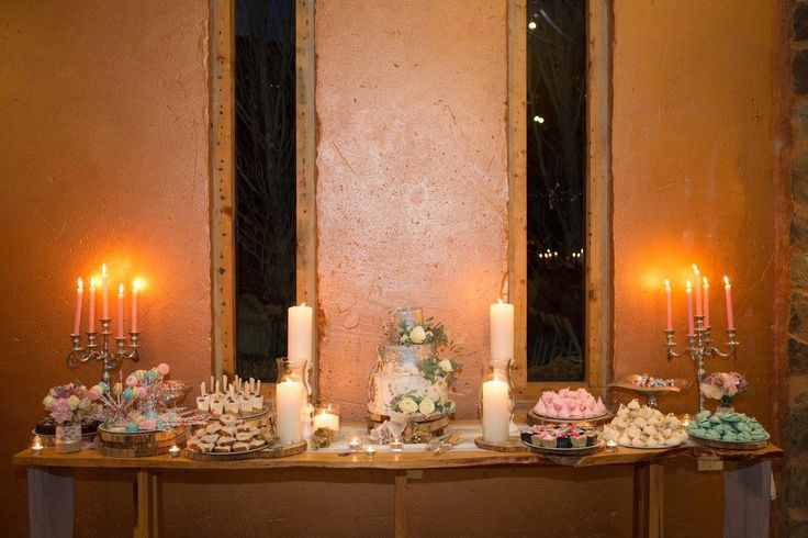Wedding dessert table with a silver and white wedding cake, Petits fours, mini meringues, Macarons made and set up by Petits Fours